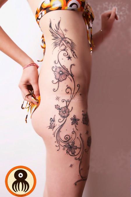 Tatuaje Para Mujeres De Flores Plantas Y Estrellas Subiendo Por El