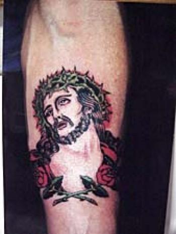Tatuaje De Cristo En La Tibia