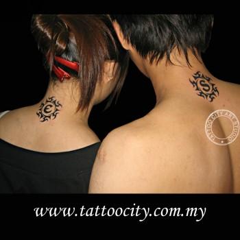 Tatuaje Para Parejas De Un Sol Con Una Inicial