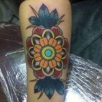 Tattoo de una flor old school en color