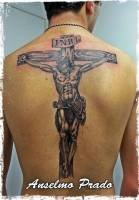 Tattoo de Jesús crucificado en la cruz en espalda entera